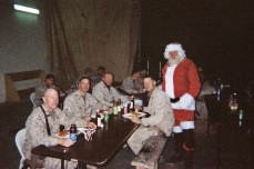 Christmas dinner in Haditha, Iraq, 2006. A KBR worker entertains as Santa Claus.